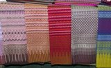 Pha Mai Yok Dok (ผ้าไหมยกดอก) is an elaborately woven material in traditional method. Originally used in the northern royal court, it became popular during the reign of King Rama VI. The distinctive craftsmanship and skills in producing this type of silk have endeared it to those who prefer the traditional designs.<br/><br/>  Lamphun was the capital of the small but culturally rich Mon Kingdom of Haripunchai from about 750 AD to the time of its conquest by King Mangrai (the founder of Chiang Mai) in 1281.